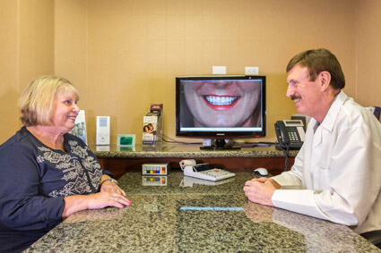 Dr. Malone and a patient meet for a dental consultation in Escondido