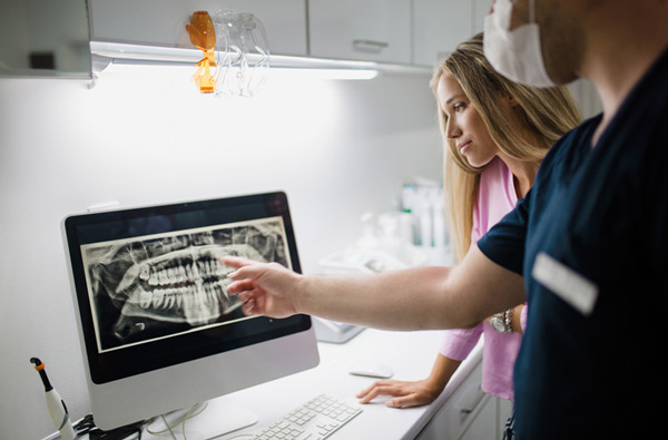 Dentist reviewing a digital x-ray in Escondido, CA